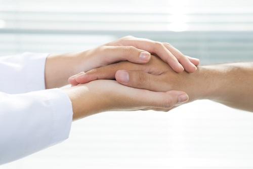 Hand holding is part of what a divorce coach does with someone going through a divorce.