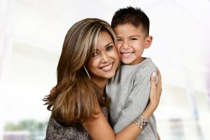Being a single divorced mom with her child, a mom hugs her boy.