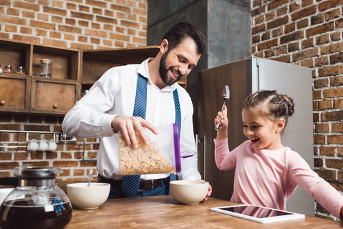 Dad making cereal for his daughter wondering if he's ready for dating after filing for divorce.