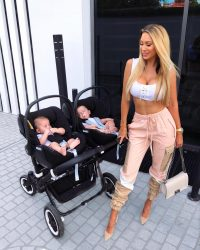 A sexy mom next to twins in a stroller.