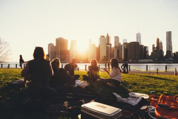 Group of people getting over a breakup or a divorce on a picnic in NYC.
