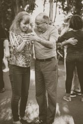 Elderly man and woman getting over a breakup or a divorce by learning how to dance together.