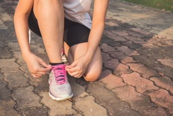 Follow this woman who is lacing up her running shoes as a way to stop feeling miserable about your divorce.