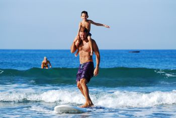 Parenting through divorce brings lots of challenges to single fathers. Surfing the waves with your son could be challenging!