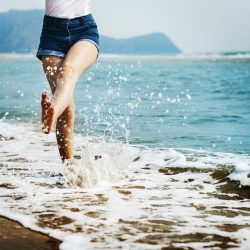 A person jumping through the waves exemplifies moving on from your divorce.