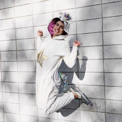 Get excited about your life again as this woman jumping wearing a bunny costume.